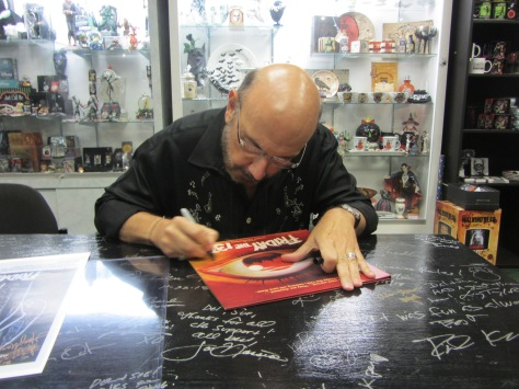 Friday the 13th film composer Harry Manfredini signs Warwork Records release of the album on vinyl last September at Dark Delicacies in Burbank, CA. Waxwork plays to release more Friday the 13th titles that Manfredini composed in the future.