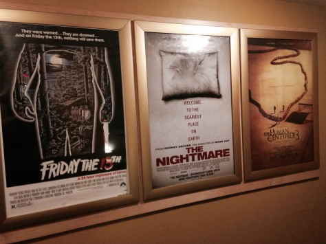 The above movie posters are just some of the old and newer films that have screened during the Coolidge After Midnight weekend series. (PHOTO BY J. KENNEY)