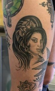 Pictured above is a tattoo of Amy Winhouse by Corey Goyette that Coogan got on her leg after Winehouse died.